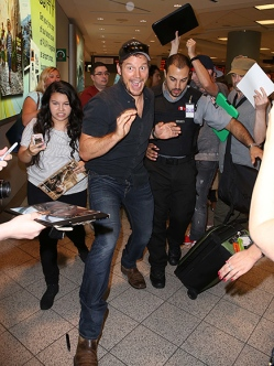 EXCLUSIVE: Chris Pratt is swarmed by fans and autograph seekers as he arrives in Toronto